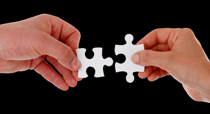 partnering advisor image of two hands putting jigsaw pieces together